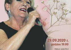 Grafika utrzymana w jasnych kolorach, zdjęcie Jadwigi Kocik w czarnej sukience, blondymka o krótkich włosach, trzyma w ręku mikrofon, na plakakcie napisy z informacjami koncercie